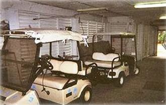 Garage Area showing the TWO 4 person golf carts included with rental