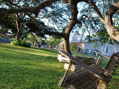 Relax in the swing under a canopy of oak trees