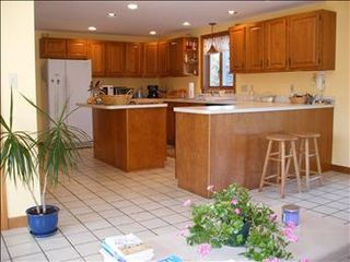 East Orleans house photo - The open kitchen is off the family room and fully equipped.