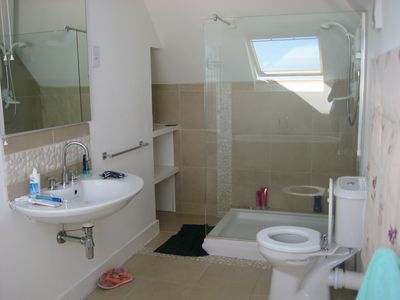 upstairs bathroom - in use!! the large shower with separate electric heater.