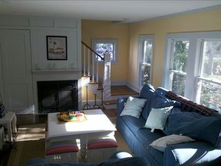 Living Room to upstairs area - hardwood floors throught includes sofabed