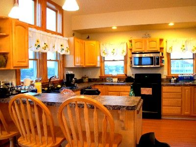 The kitchen, dining and great room have vaulted ceilings and great views!