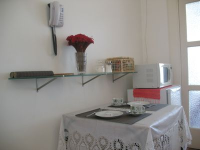 """Living Room"" with dining table, microwave and fridge"