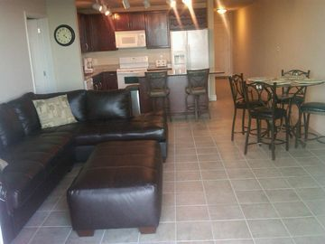 Lake Town Wharf condo rental - Living Room with Sleeper & Kitchen