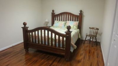 Queen bed in downstairs bedroom.