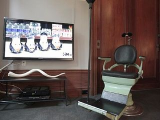Vintage dentist chair and 46' LED flatscreen. - Harlem apartment vacation rental photo
