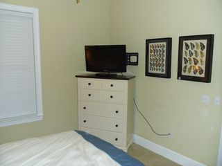 "Guest Bedroom #2 with wall-mounted 32"" LCD TV and Blu-Ray DVD player. - Santa Rosa Beach condo vacation rental photo"