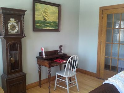 The living room has a writing desk, perfect for catching up on emails.