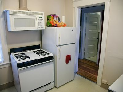 Gas range in the kitchen, also vented microwave, and all utensils, etc.