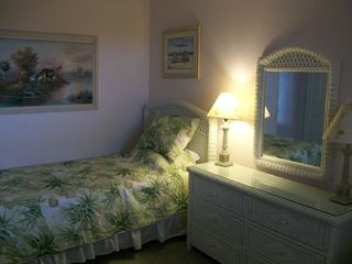 Sanibel Island condo photo - Guest Bedroom has an HDTV installed on the wall in front.