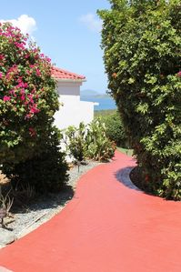 Follow the red brick pathway to the refreshing pool and deck.