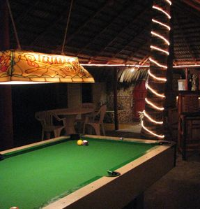 Inside Tikki Hut Billiard table at night!