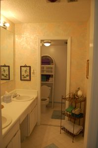 Full bathroom adjoining master bedroom with double sinks and shower
