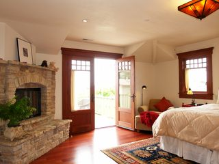 Pacific Grove house photo - Master Bedroom has fireplace and private ocean view balcony.