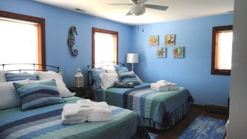 Ocean Blue Bedroom With Two Queen Beds.
