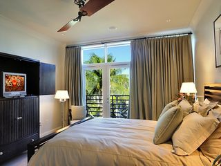 The second bedroom also has a TV and sliding doors to the balcony. - Key West condo vacation rental photo