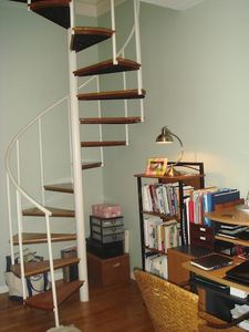 Duplex spiral stairway to study and master bedroom