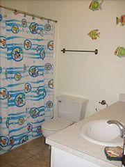 Cape San Blas house photo - Main level bath is decorated in a colorful theme