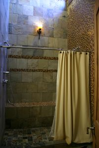 Upper master bathroom shower, with vaulted ceiling and showerheads on both sides