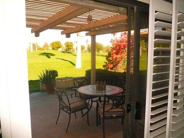 Bermuda Dunes condo rental - Covered back patio with table.