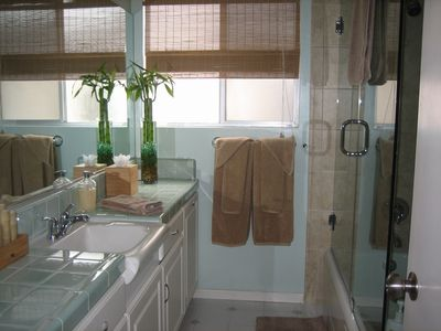 Upstairs enclosed glass full bath and shower