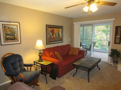 Branson condo rental - The living room has a queen sized sofa sleeper & a glider rocker.
