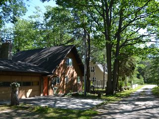 Cheboygan house photo - Driveway, garage and house.