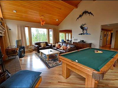 Large Windows and Pool Table in the Living Room