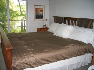 Master bedroom suite-overlooks lake and has large bathroom with whirlpool.
