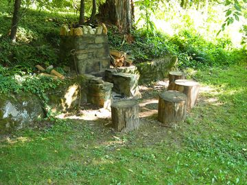 Rustic outdoor fireplace, perfect for marshmallow toasting or a moonlit campfire