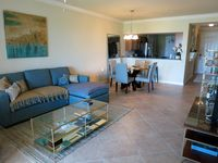 Turnkey 2/2 condo with golf privileges and luxury amenities, close to beaches