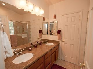 Phoenix house photo - Master bath with 2 sinks, granite countertops, premium light fixtures