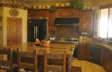 Picture yourself preparing a scrumptious meal in this kitchen .