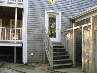 Wellfleet house photo - The oversized outside shower with stairs directly to the house.