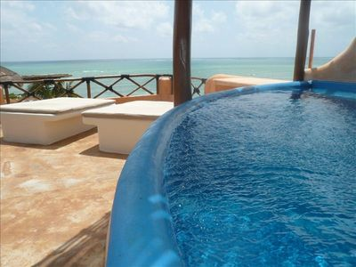 View of plunge pool and the rooftop sunbeds