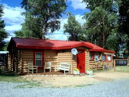 Adorable & Historic Tie Hack Cabin has outside sitting area to enjoy Mtn. Vi