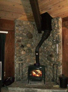 Green burning wood stove in living room
