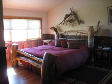 King size bed in one of the two upstairs bedroom.