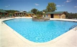 Branson cabin photo - Amenities like large outdoor pool, playground, picnic shelter, discount tickets.