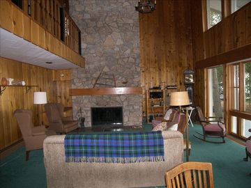 View of the living room and the massive stone wall fireplace.
