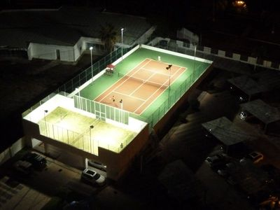 Lit tennis courts for daytime or nightime games.