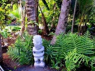 Pahoa cottage photo - Outdoor tiki statue welcomes you!