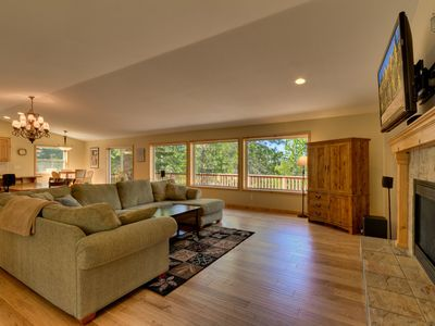 Show off your wildlife photography on the large flatscreen TV in this spacious living room.