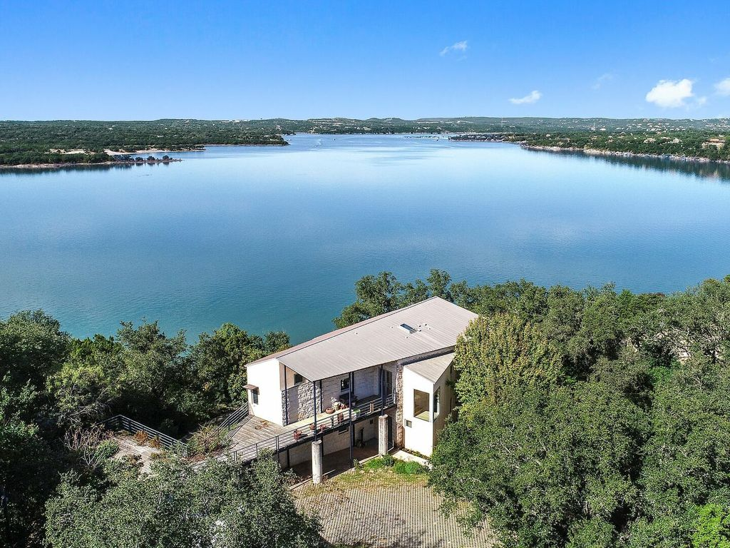 NEW!!! Stunning secluded lake house nestled among trees and perched on the edge of Lake Travis