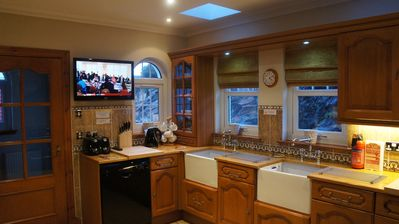 Fabulous kitchen even with a wall mounted Tv