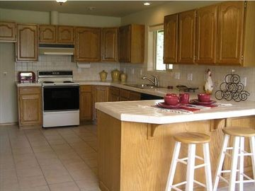 KITCHEN/BREAKFAST BAR/LOTS OF CABINETS/COUNTER SPACE/ STOVE/REFRIGERATOR/FREEZER