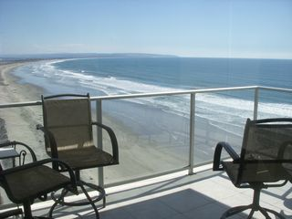 Condo balcony and view of Silver Strand - great dolphin watching! - Coronado condo vacation rental photo