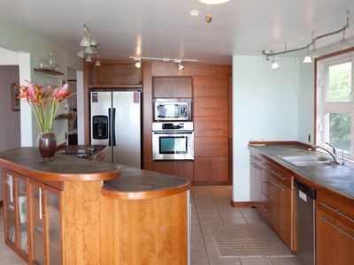 Laie house rental - Modern kitchen features concrete counters and Euro styling