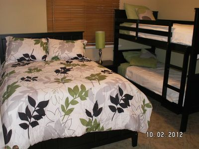 Kids bedroom with a double bed and twin bunk beds