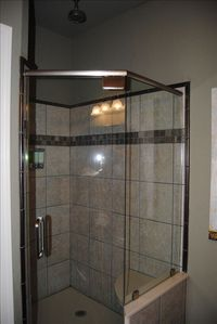 Master shower with shower head on the wall and rainfall shower head. Relaxing!